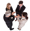Businesspeople holding hands - teamwork