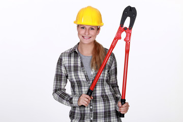 Woman holding large bolt-cutters