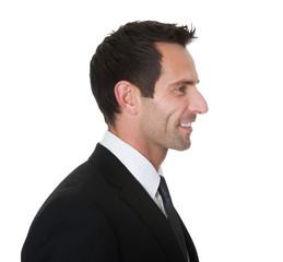 Portrait of happy middle aged businessman