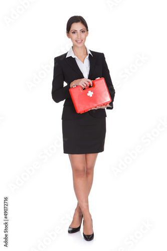 Happy Businesswoman Holding First Aid Box
