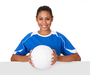 Happy Young Girl Holding Volleyball And Placard