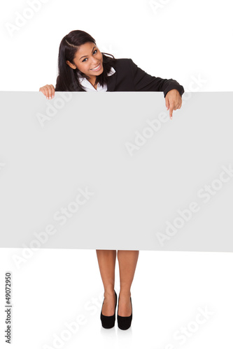 Happy Businesswoman Holding Placard