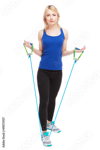 Woman exercising with a rubber band