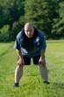 canvas print picture - Übergewichtiger Mann macht Sport