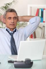 Senior man with his laptop