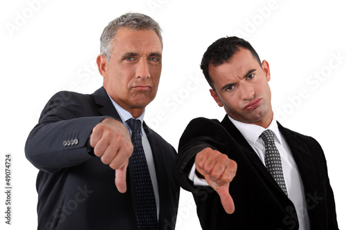businessmen, thumbs down