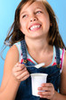 Cute girl with probiotic rich yoghurt