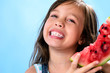 Cute happy young girl kid with red juicy watermelon