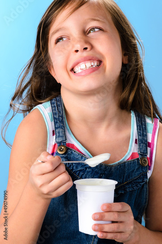 Cute girl with probiotic rich yoghurt