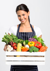 Smiling chef with fresh local organic produce