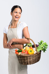 Smiling woman with fresh produce