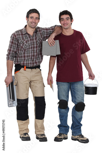 Two men preparing to tile bathroom