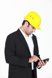 Man with helmet and cell phone