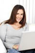 beautiful woman using laptop on sofa