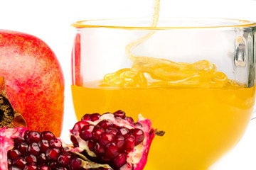 pomegranate and honey flowing in a cup