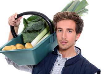 young farmer with a vegetables basket