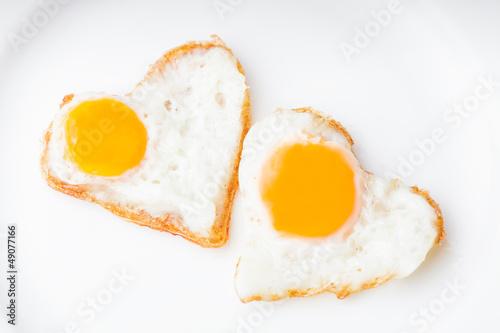Leinwanddruck Bild Heart fried eggs