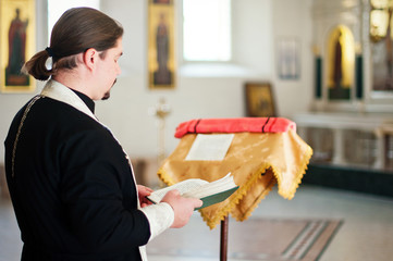 A  priest  in the church