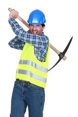 Aggressive labourer holding a pickaxe
