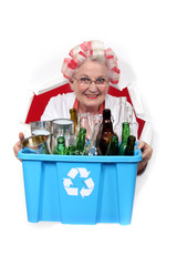 Old woman recycling
