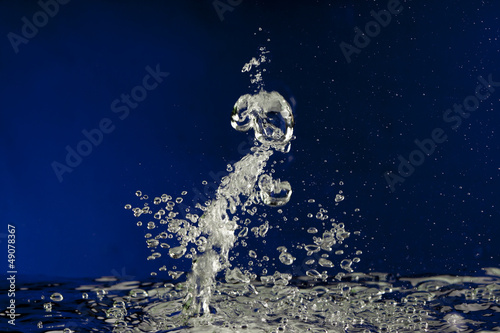 Water splash bubbles abstract background in blue