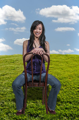 Beautiful Asian Woman Sitting