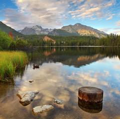 Mountain Lake in Slovakia Tatra - Strbske Pleso with dramatic cl