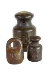 Three of the old weights for scales