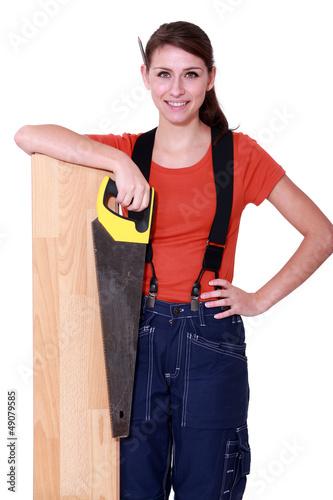 craftswoman holding a handsaw