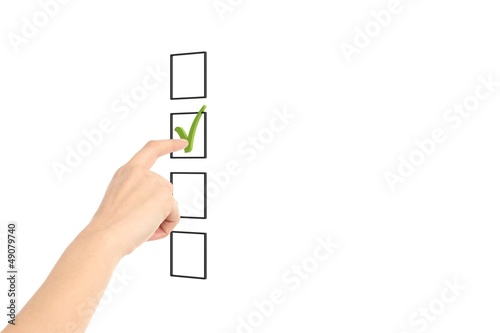 Woman hand checking tick box