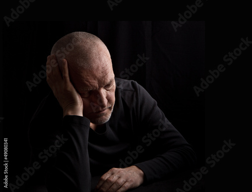 Portrait of very sad senior man