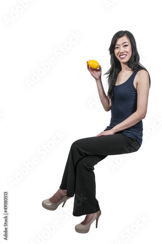 Woman Sitting with a lemon