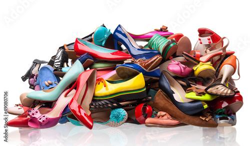 Leinwanddruck Bild Pile of various female shoes over white
