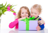 2 kids with gift and flowers
