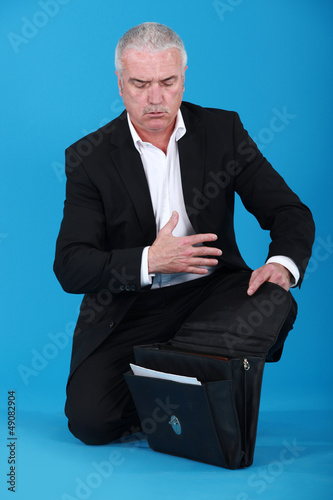 Businessman with an open briefcase