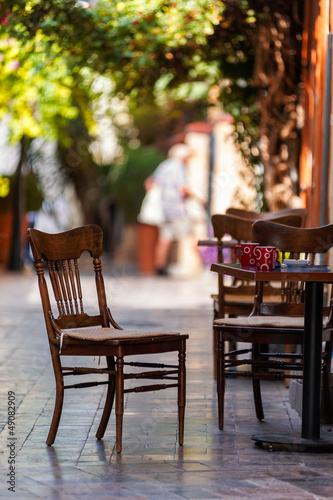 Empty coffee terrace with tables and chairs