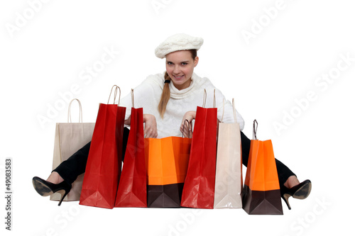 Fashionable woman surrounded by her shopping bags