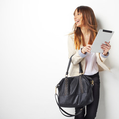 Happy business woman with a digital tablet computer