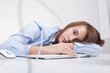 Beautiful woman tired at work