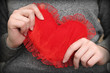 red heart in woman's hands, close-up