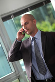 Concerned businessman making important call