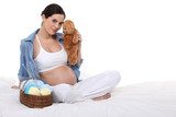 cute pregnant brunette with teddy bear