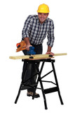 Man smoothing plank of wood with sander poster