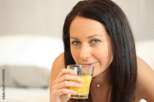 Brunette woman with orange juice
