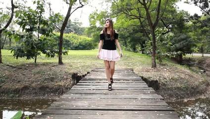 Beautiful african thai girl walking on a bridge