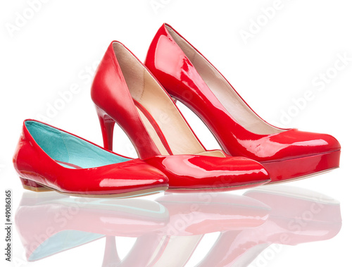 Three different female shoes over white background