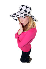 High-angle shot of a woman wearing a funky hat