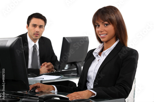 Business professionals working behind their desks