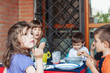 Group of kids having lunch together.