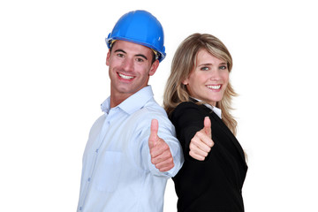 Engineer and a tradesman giving the thumb's up